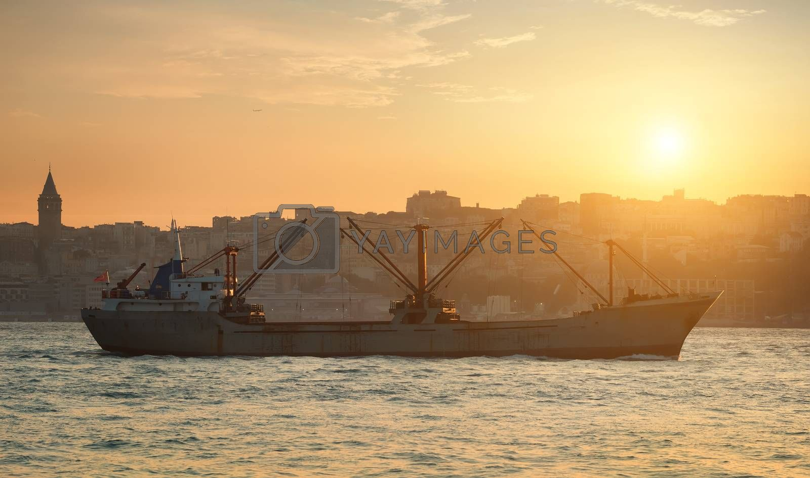 Cargo ship in Istanbul at sunset, Turkey