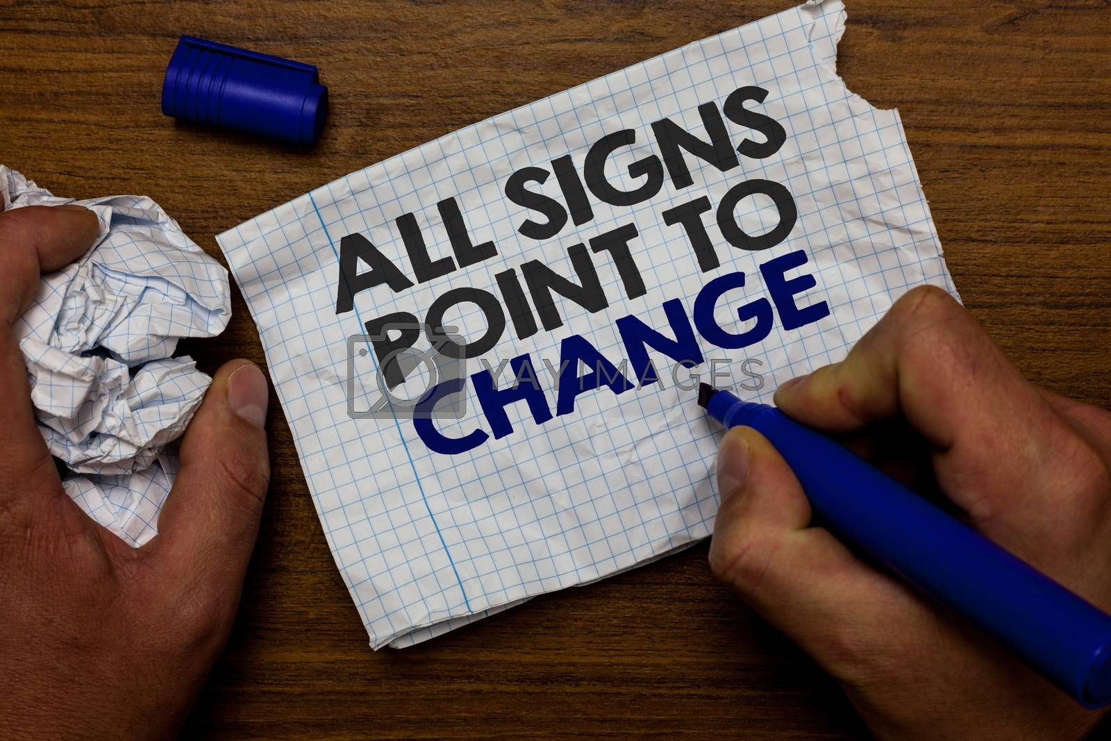 Word writing text All Signs Point To Change. Business concept for Necessity of doing things differently new vision Hand hold paper lob and blue marker wooden base with torn white written page