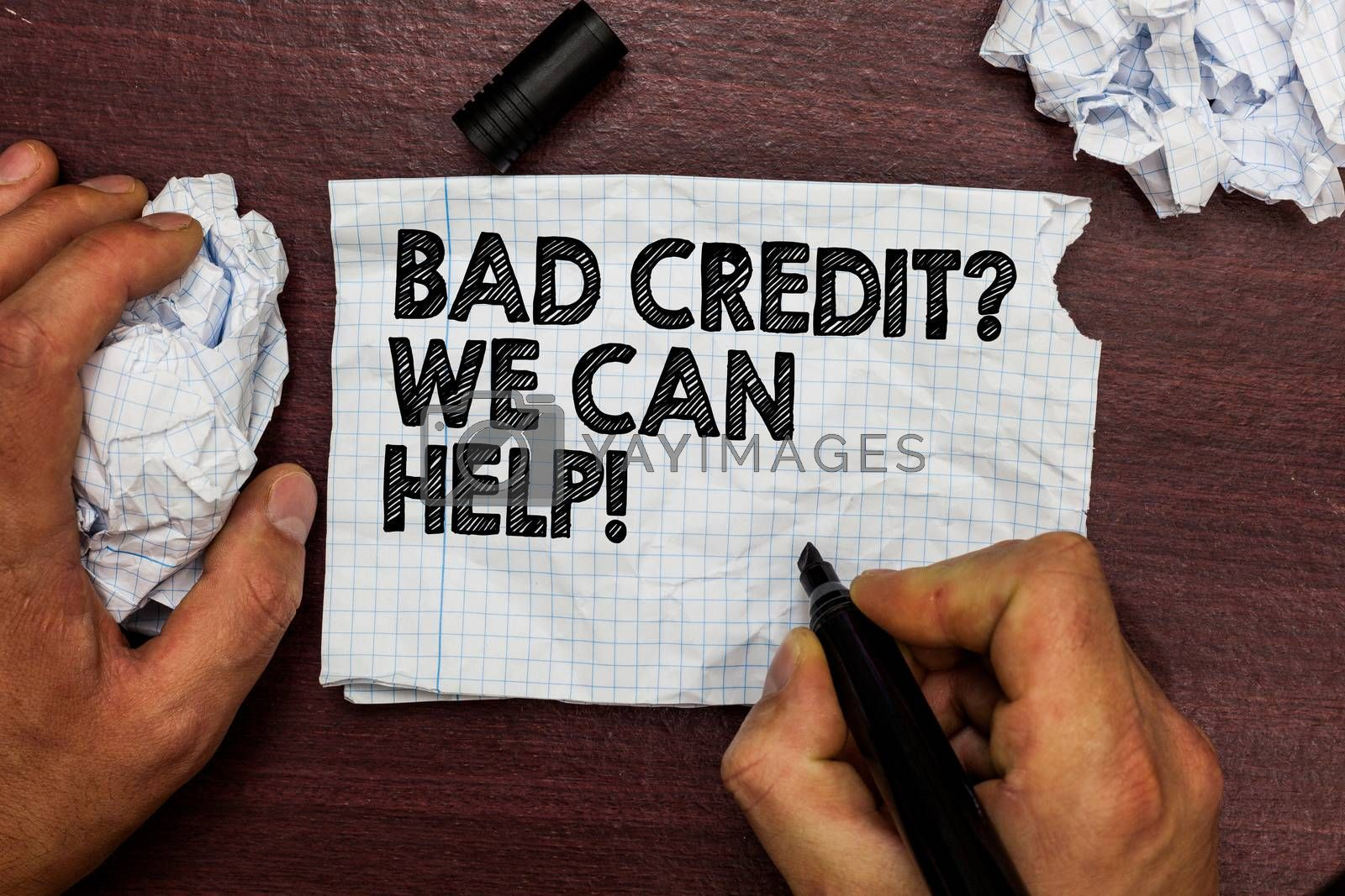 Conceptual hand writing showing Bad Credit question We Can Help. Business photo text Borrower with high risk Debts Financial Hand hold pen sketch word on torn page woody deck hand paper ball