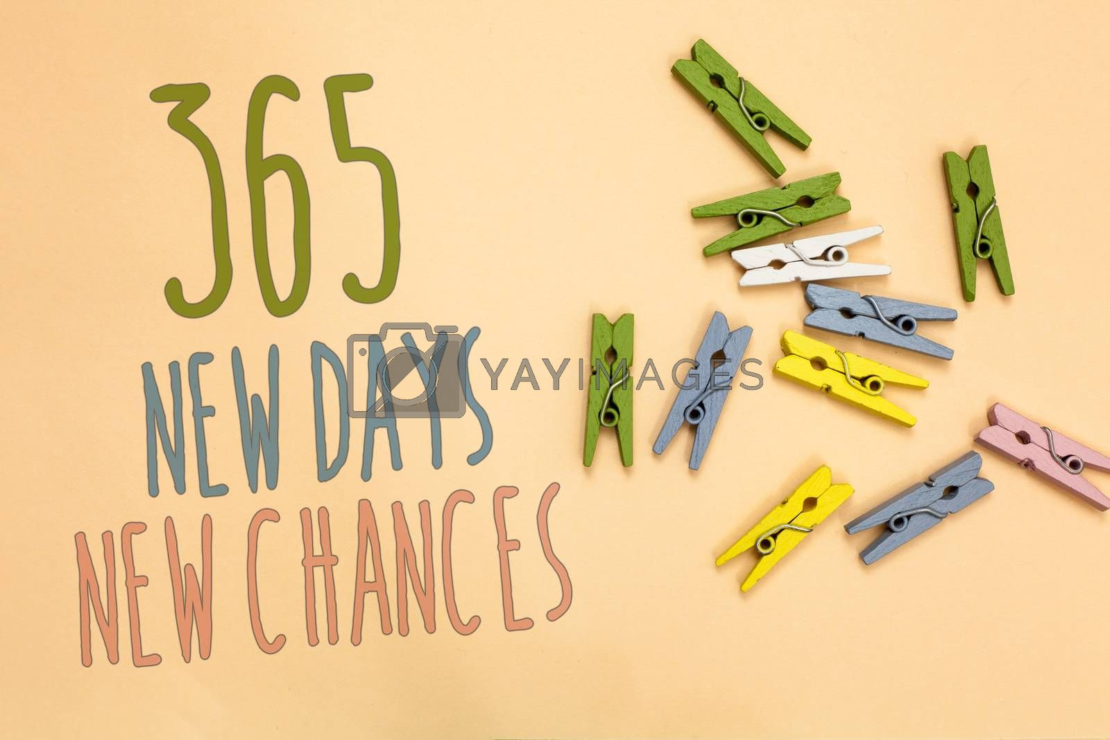 Text sign showing 365 New Days New Chances. Conceptual photo Starting another year Calendar Opportunities Yellow base with painted texts colorful paper clips laid randomly on ground