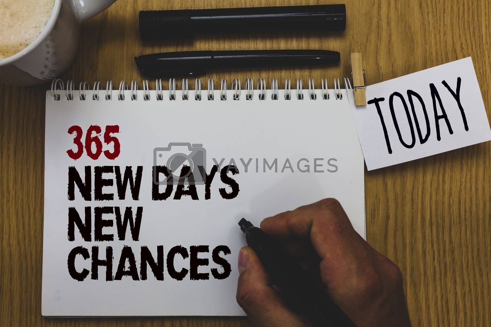 Conceptual hand writing showing 365 New Days New Chances. Business photo text Starting another year Calendar Opportunities Written on paper hand hold pen clipper grip sticky note black pen