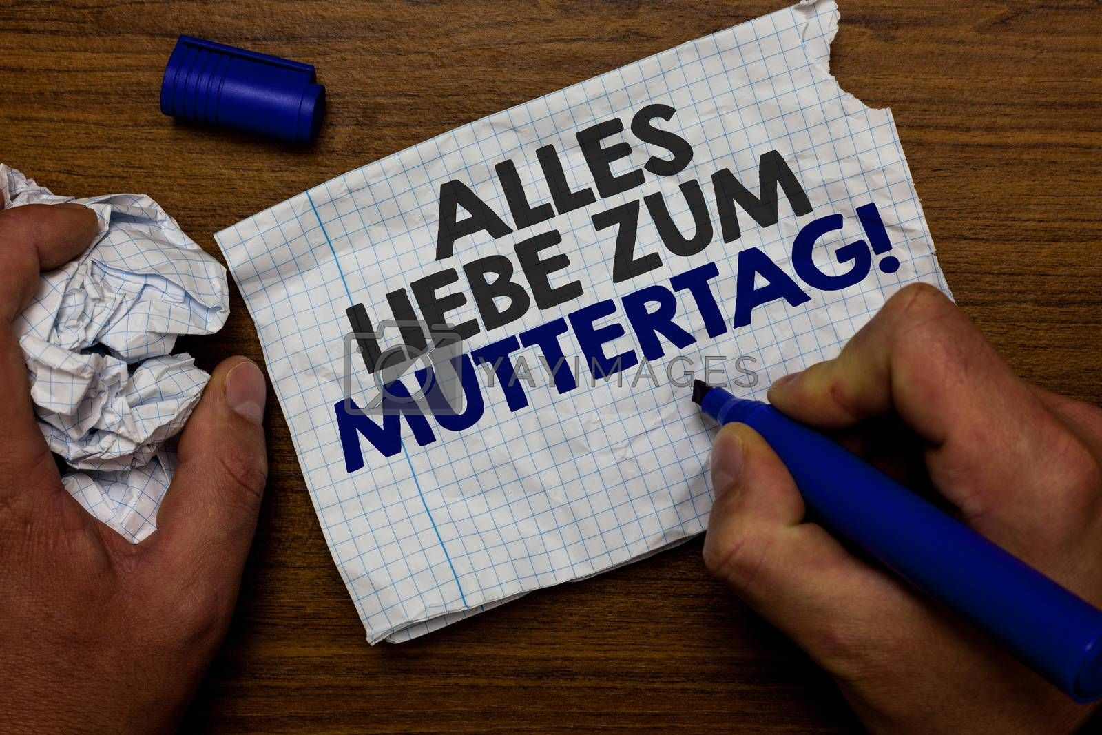 Word writing text Alles Liebe Zum Muttertag. Business concept for Happy Mothers Day Love Good wishes Affection Hand hold paper lob and blue marker wooden base with torn white written page. by Artur Szczybylo