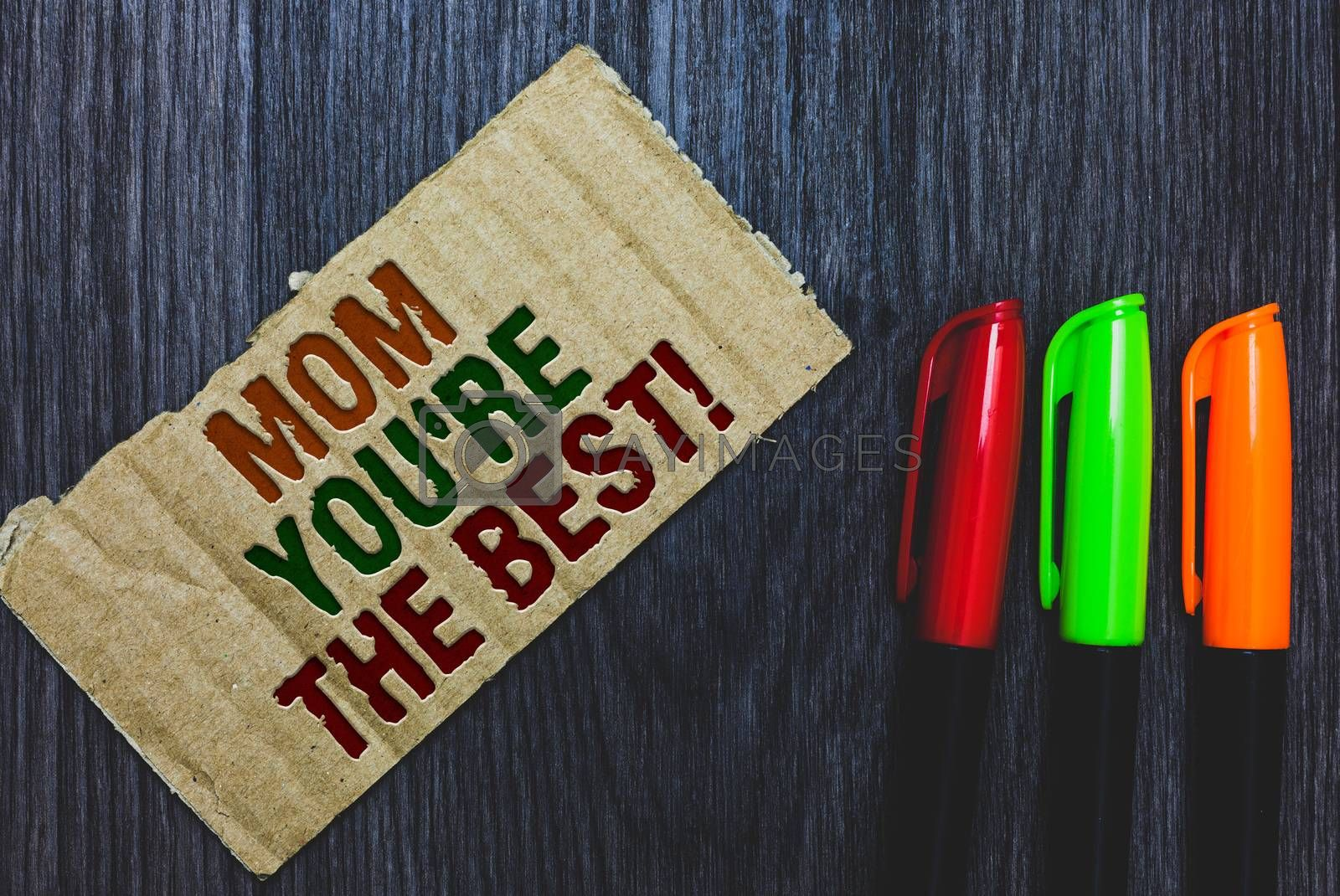 Writing note showing Mom You re are The Best. Business photo showcasing Appreciation for your mother love feelings compliment Cardboard with letters on grey wooden desk colorful pens laid rank. by Artur Szczybylo