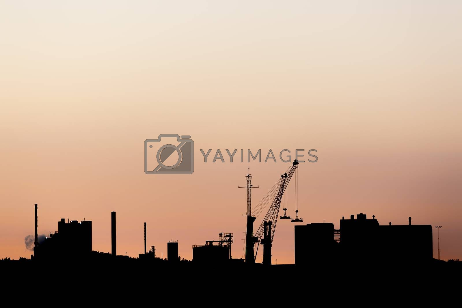 Industrial Building Silhouette at Sunset with a clear sky.