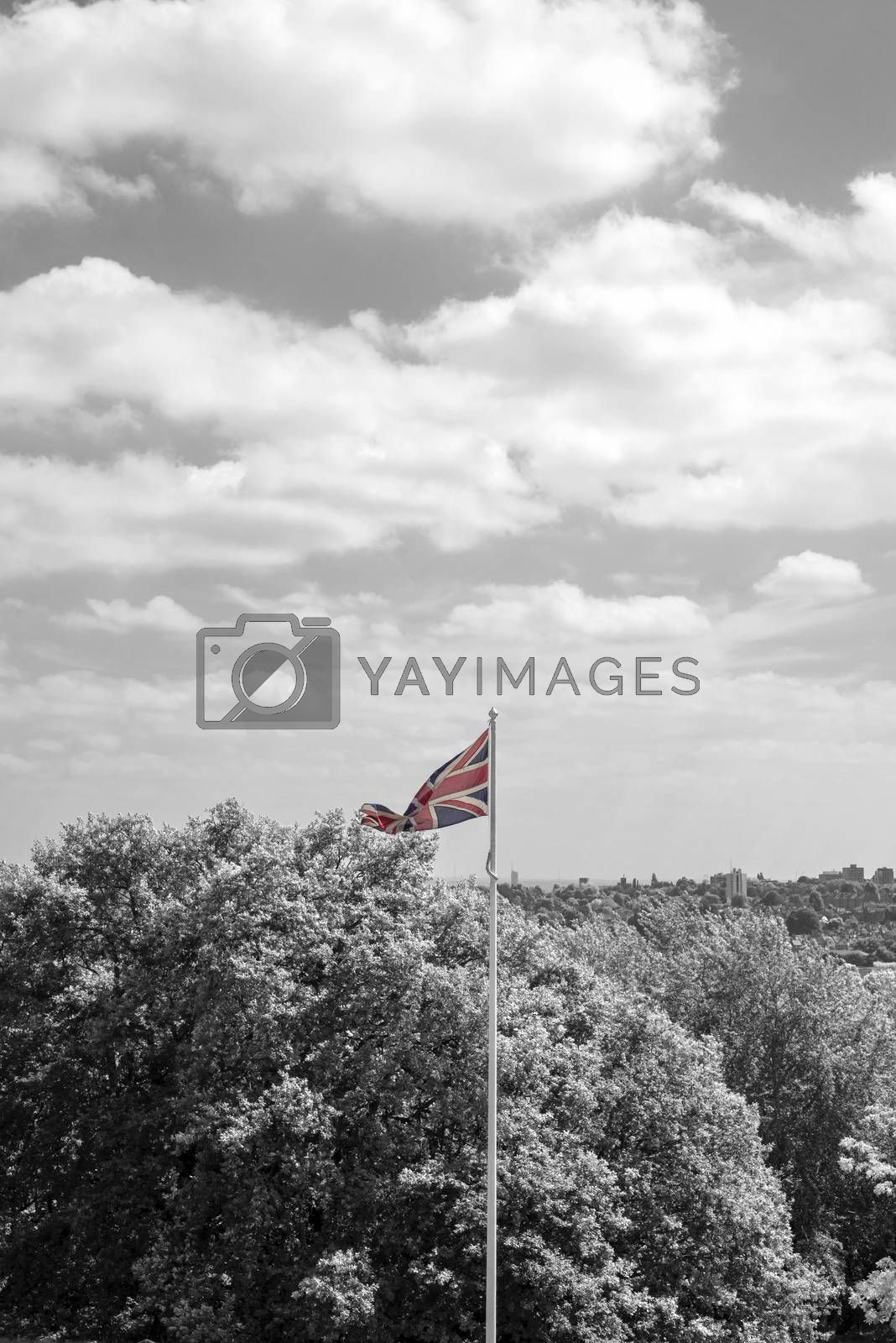 union jack flag flying from a pole in london in black and white
