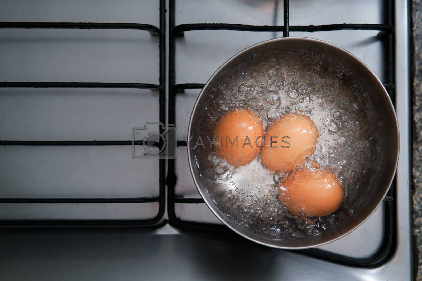 Royalty free image of eggs in boiling water by antpkr