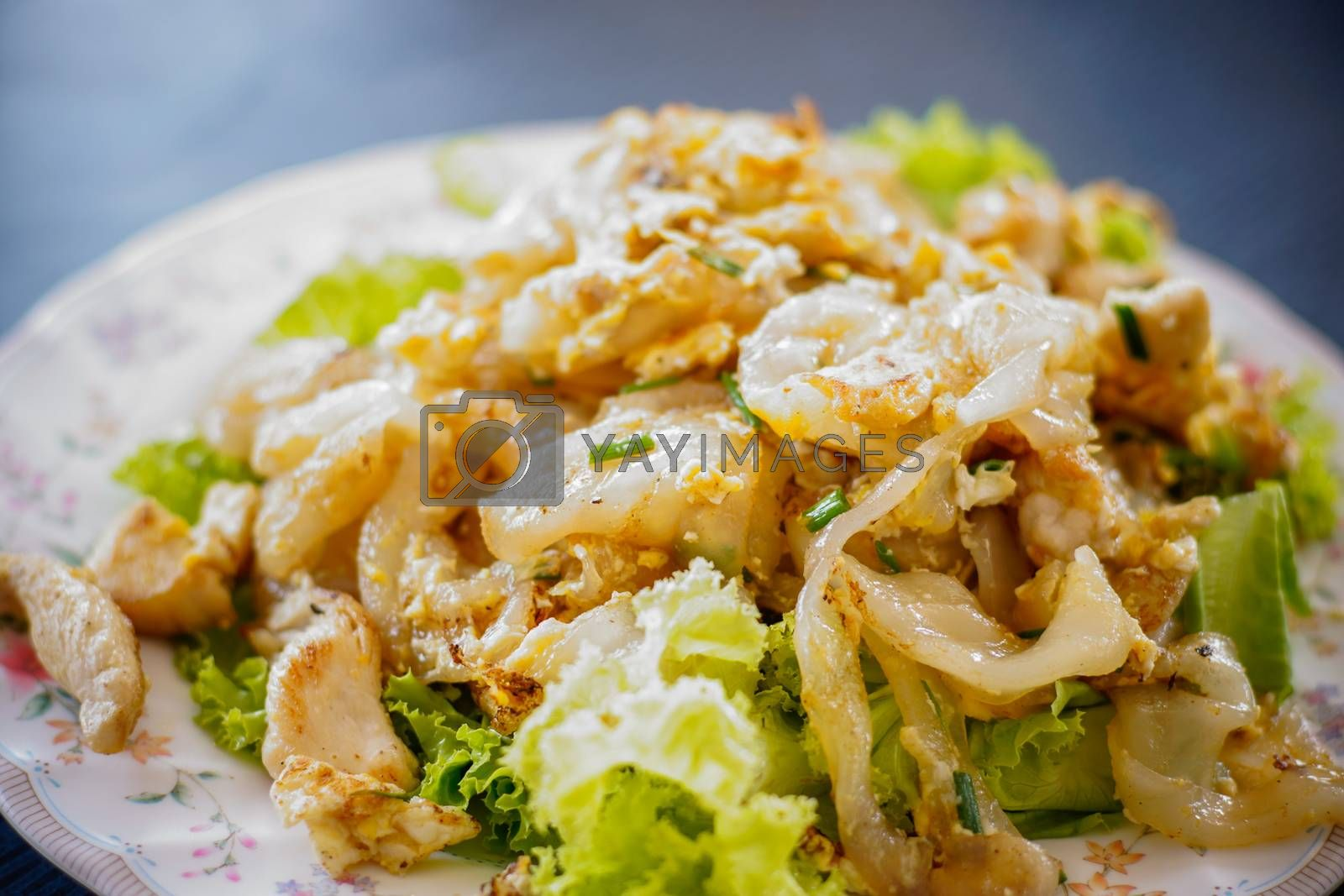 Royalty free image of fried noodles with chicken by antpkr
