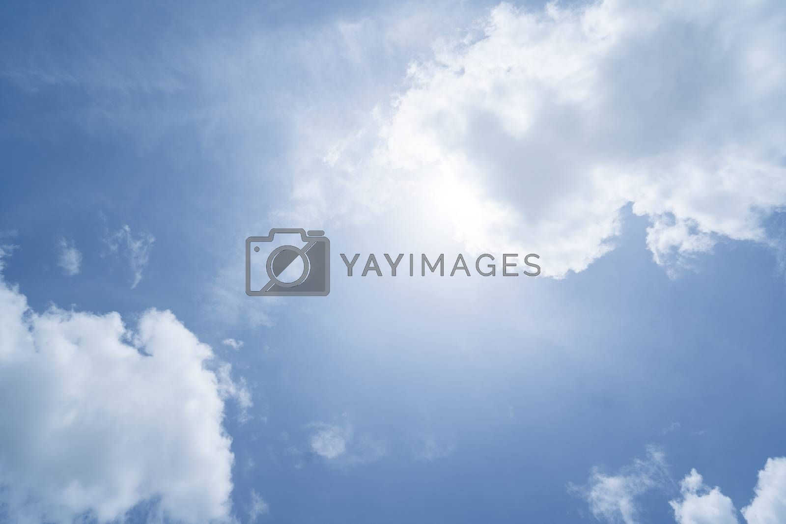 Royalty free image of soft sun and blue skies by antpkr