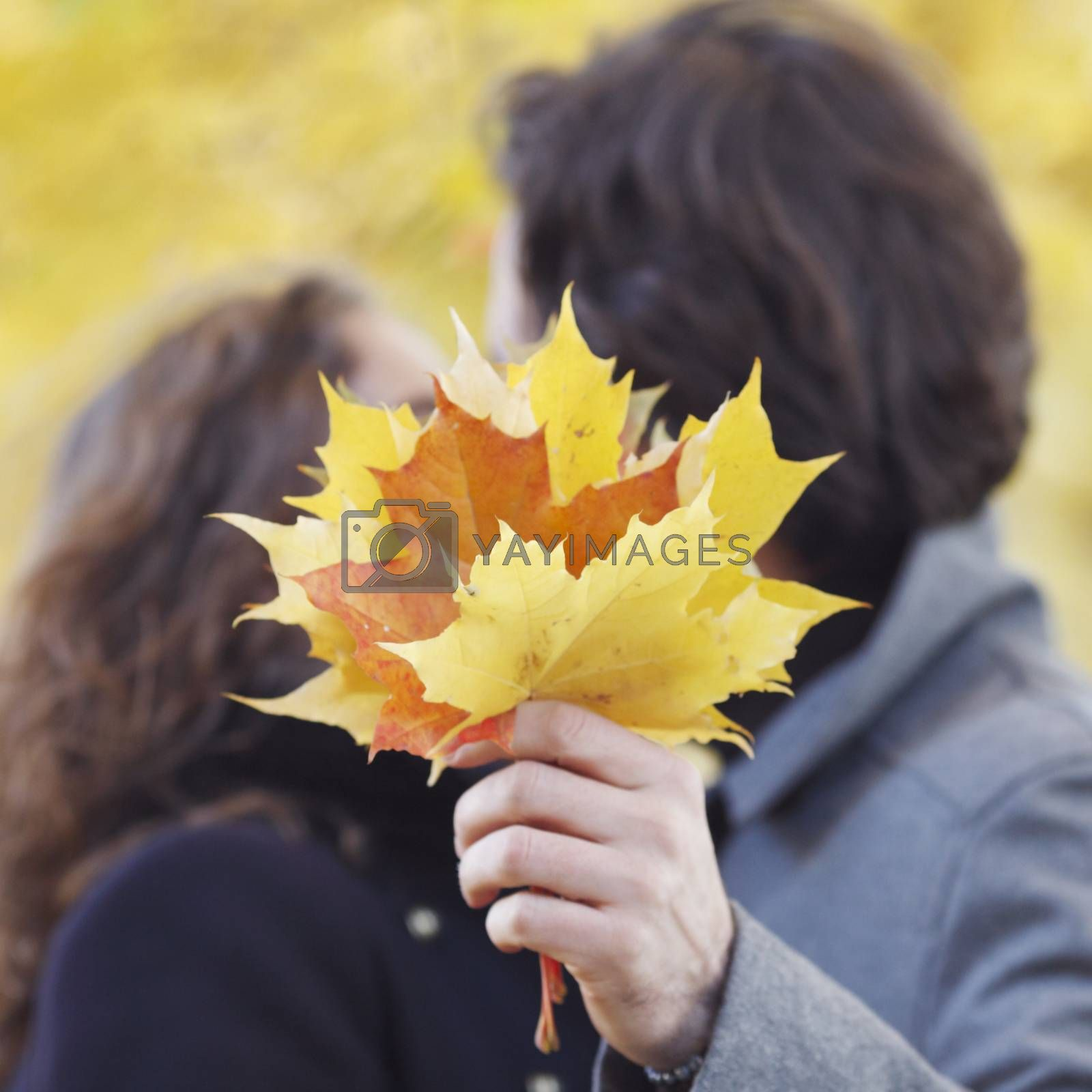 Couple kissing in autumn park, love, relationship, family and people concept