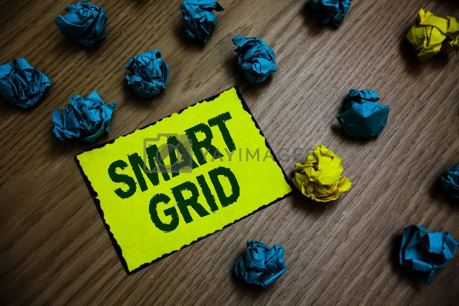 Word writing text Smart Grid. Business concept for includes of operational and energy measures including meters Yellow piece paper reminder lots crumpled papers several tries wooden floor