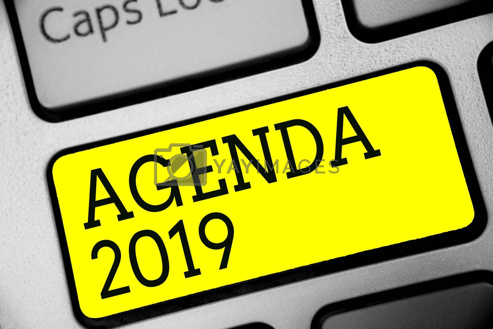 Text sign showing Agenda 2019. Conceptual photo list of activities in order which they are to be taken up Keyboard yellow key Intention create computer computing reflection document
