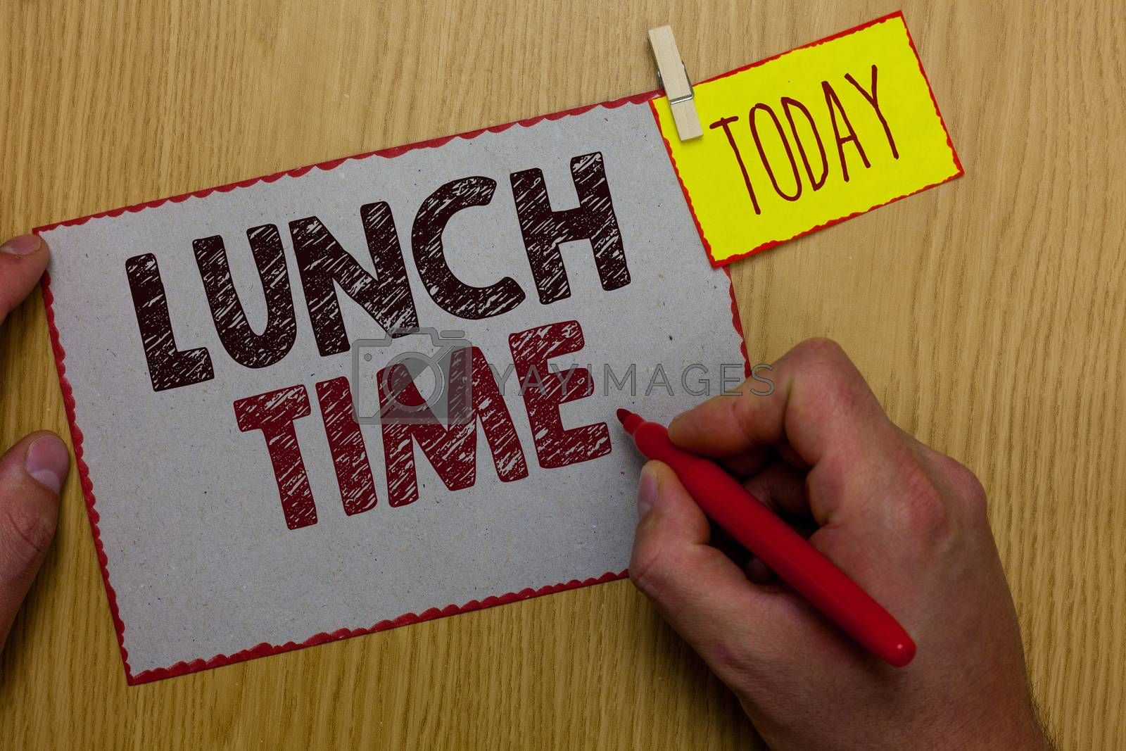Word writing text Lunch Time. Business concept for Meal in the middle of the day after breakfast and before dinner Man holding marker paper clothespin reminder express ideas wooden table