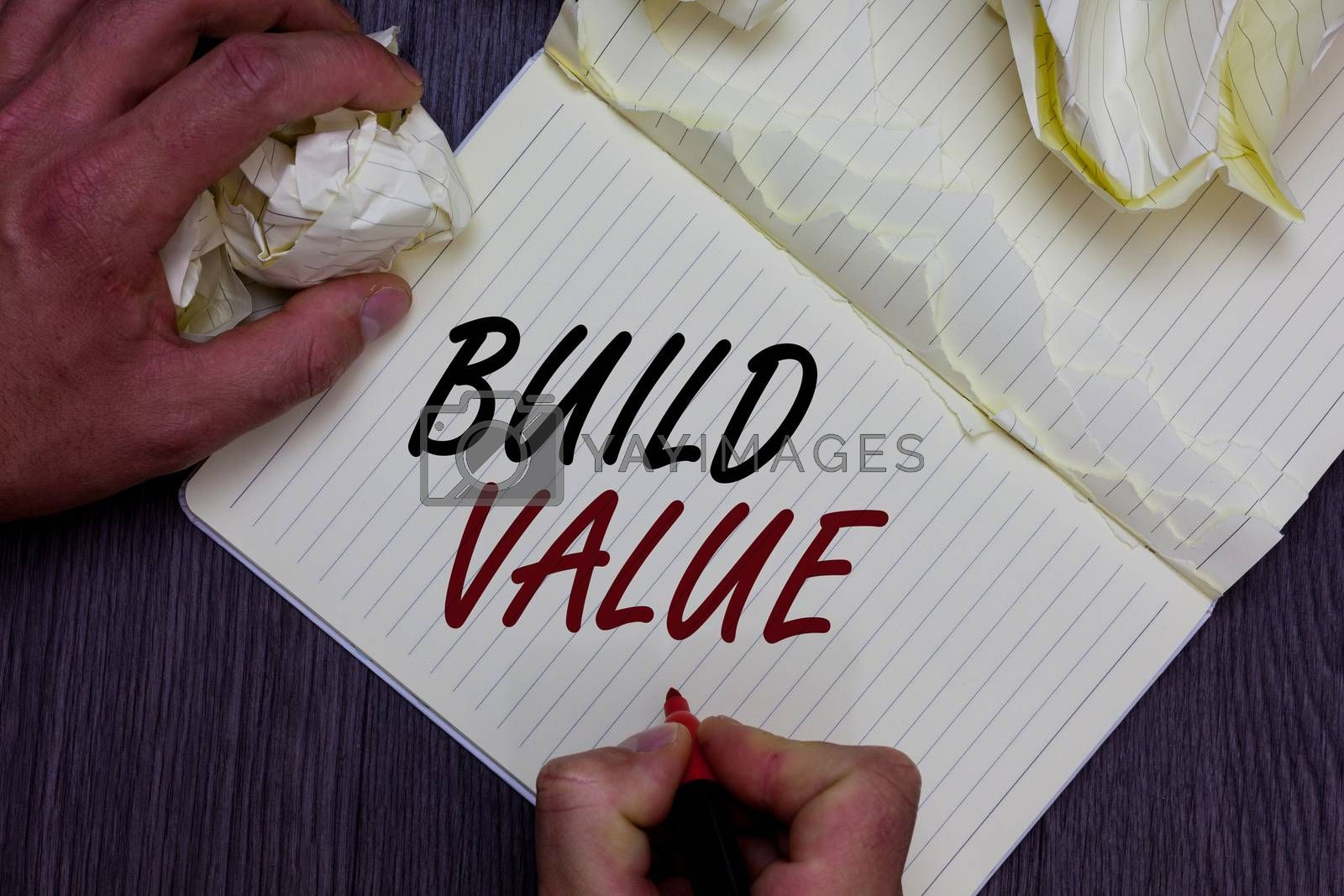 Word writing text Build Value. Business concept for efficient enough way that it will generate profit after cost Man holding marker notebook crumpled papers ripped pages mistakes made