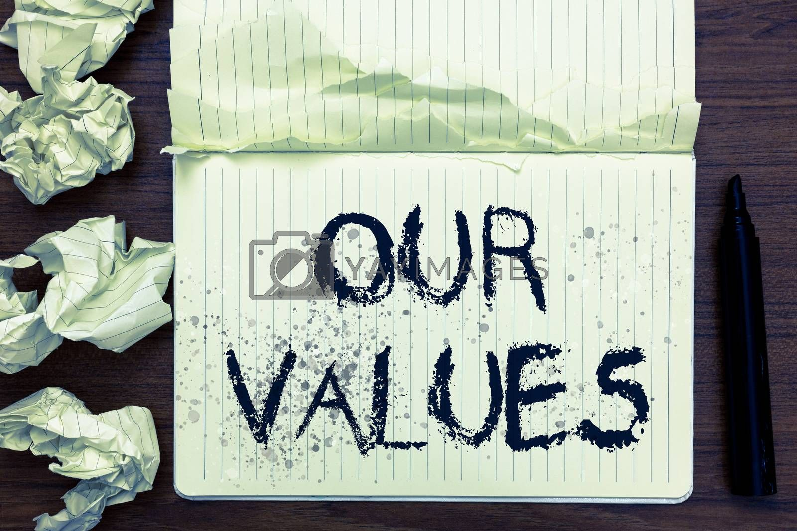 Word writing text Our Values. Business concept for list of morals companies or individuals commit to do them Open notebook page crumpled papers ripped pages several tries mistakes