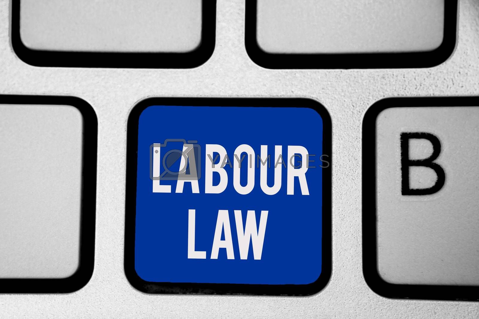 Word writing text Labour Law. Business concept for Rules implemented by the state between employers and employee Keyboard blue key Intention create computer computing reflection document