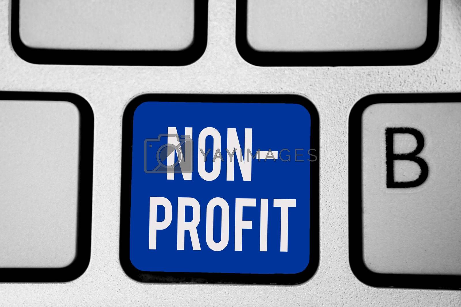 Word writing text Non Profit. Business concept for providing products or service without paying back in return Keyboard blue key Intention create computer computing reflection document