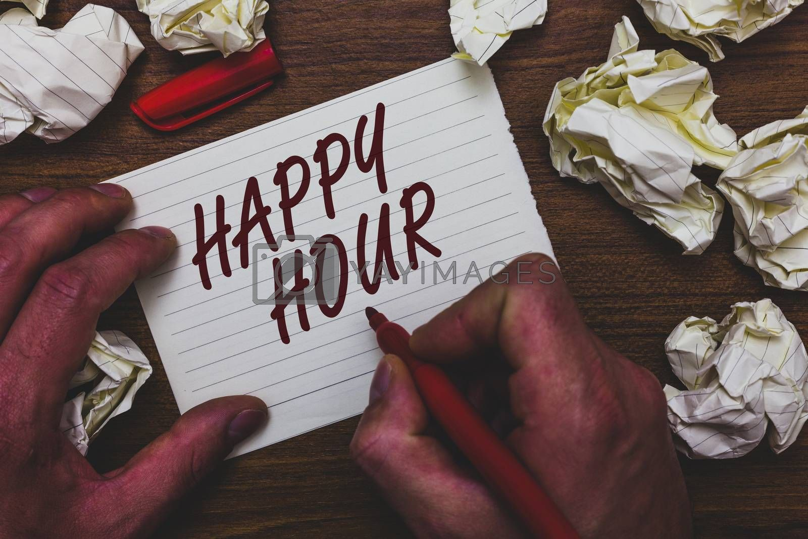 Handwriting text writing Happy Hour. Concept meaning Spending time for activities that makes you relax for a while Man holding marker notebook page crumpled papers several tries mistakes
