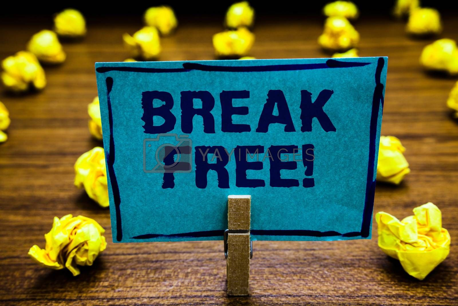 Word writing text Break Free. Business concept for another way of saying salvation out of chains freedom prison Clothespin holding blue paper note crumpled papers several tries mistakes