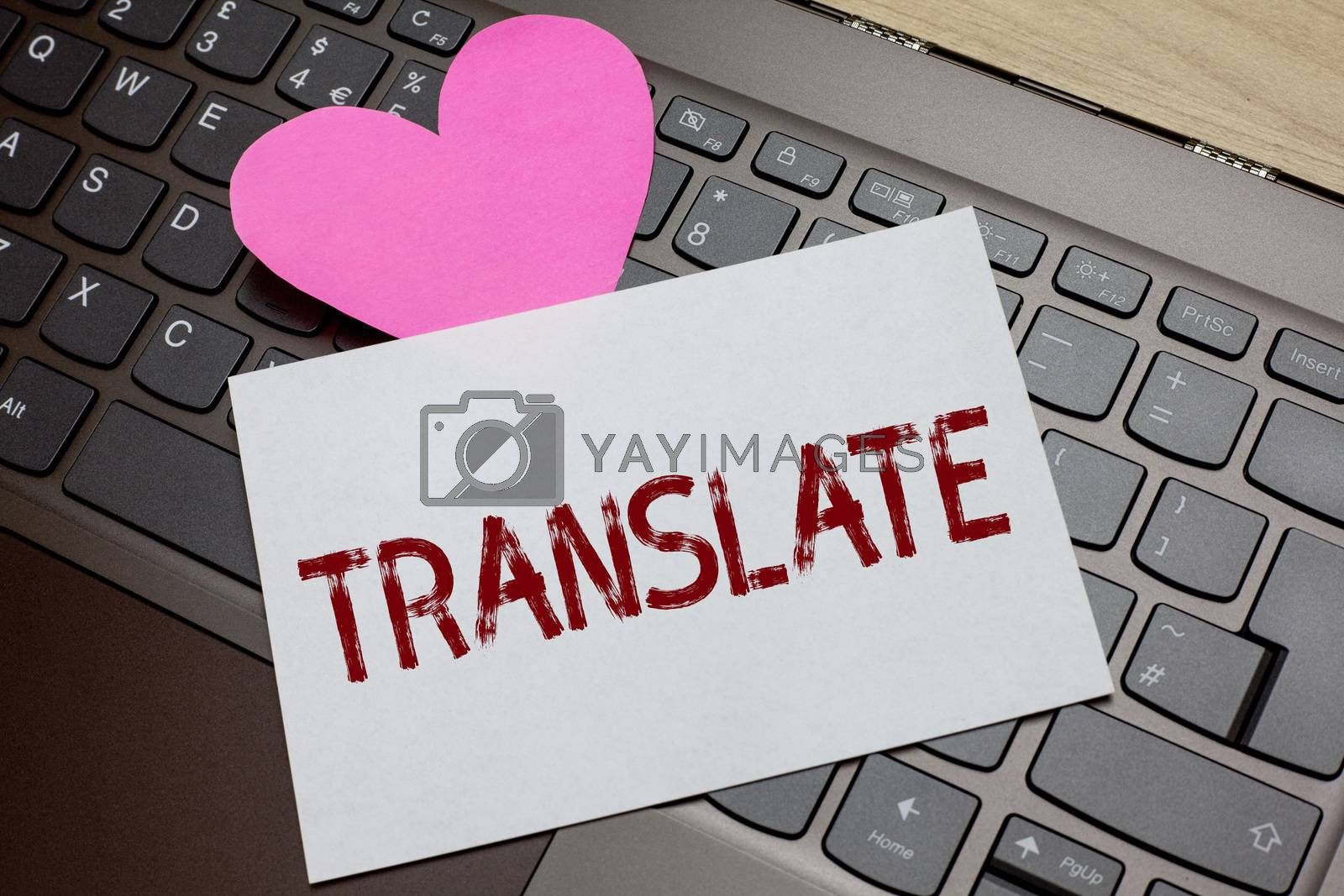 Word writing text Translate. Business concept for Another word with same equivalent meaning of a target language Paper Romantic lovely message Heart Keyboard Type computer Good feelings