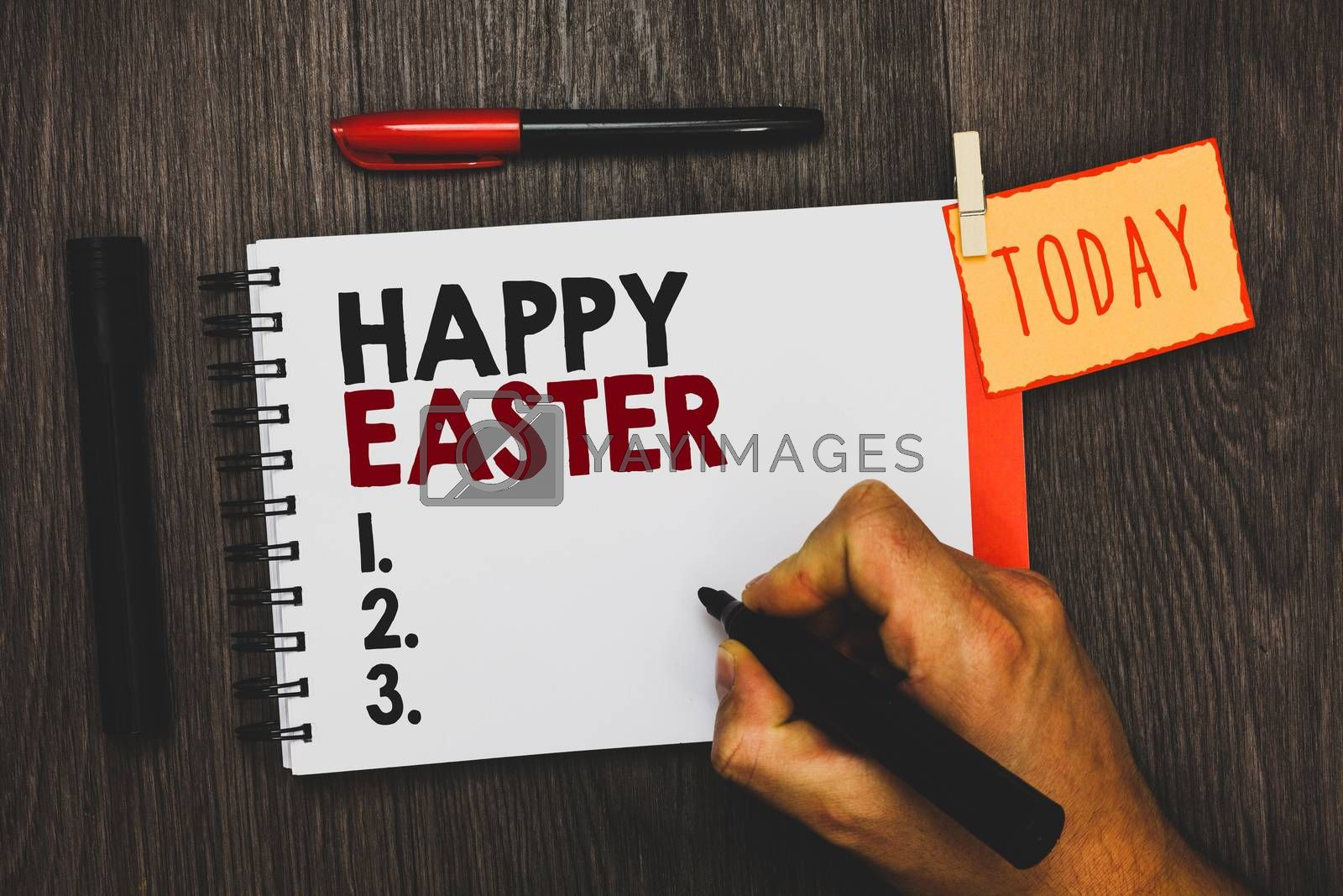 Text sign showing Happy Easter. Conceptual photo Christian feast commemorating the resurrection of Jesus Man holding marker notebook clothespin hold reminder cup markers wood table