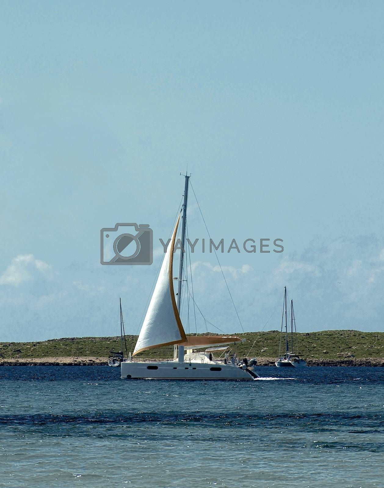 Small White Yachts in Beauty Harbor against Azure Sky near North West Coast of Menorca, Balearic Islands