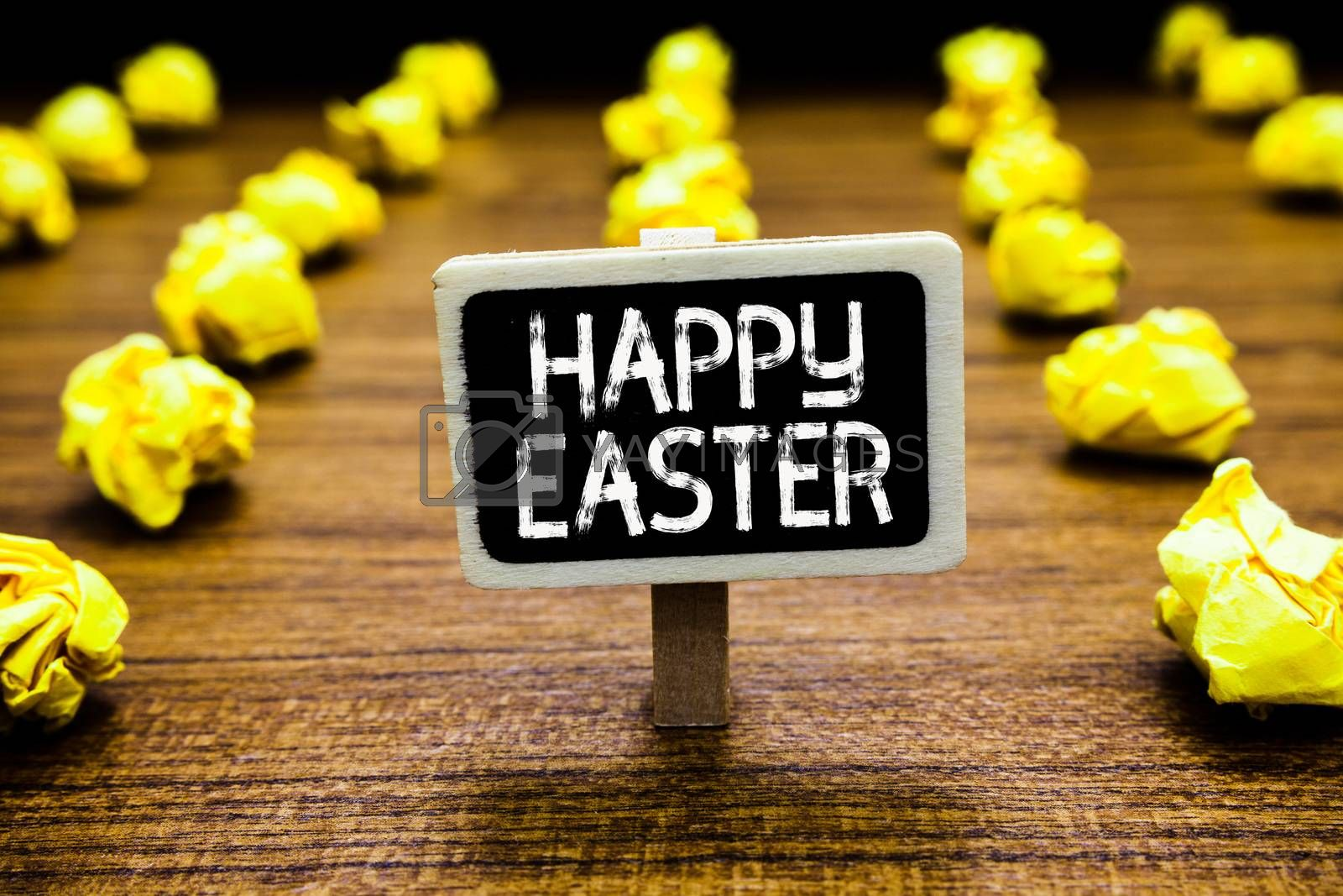 Handwriting text Happy Easter. Concept meaning Christian feast commemorating the resurrection of Jesus Blackboard crumpled papers several tries mistake not satisfied wooden floor