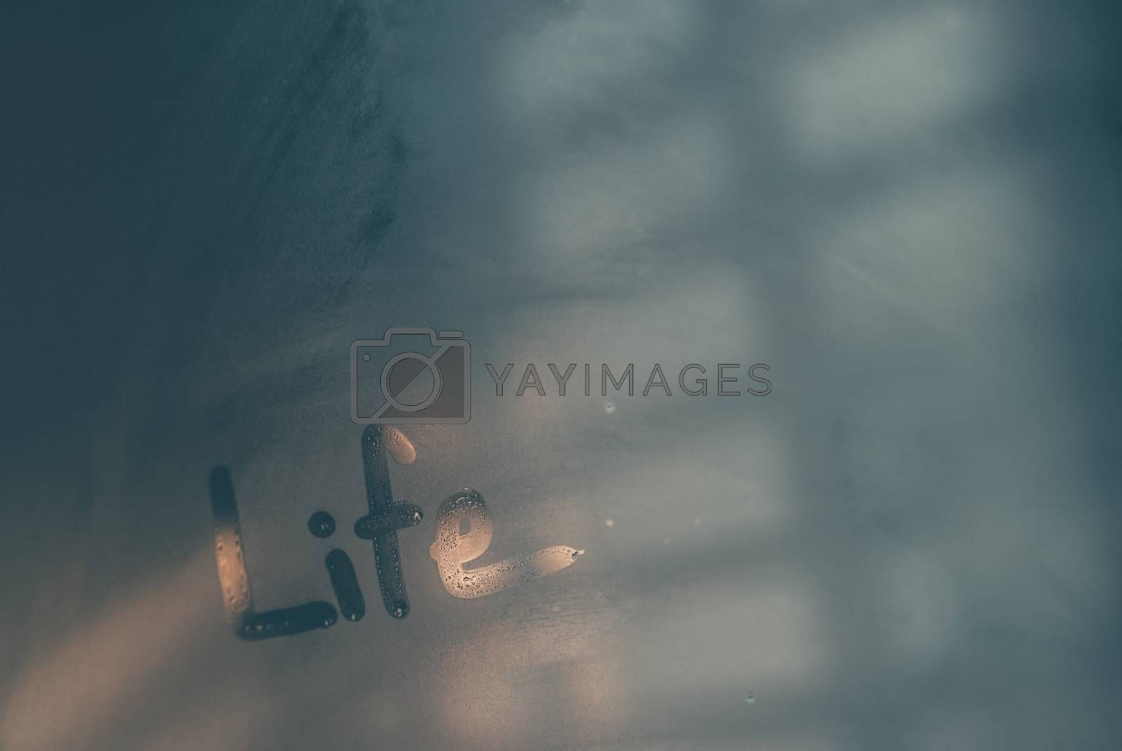 Abstract conceptual background, misted-up window glass with written word on it, life concept