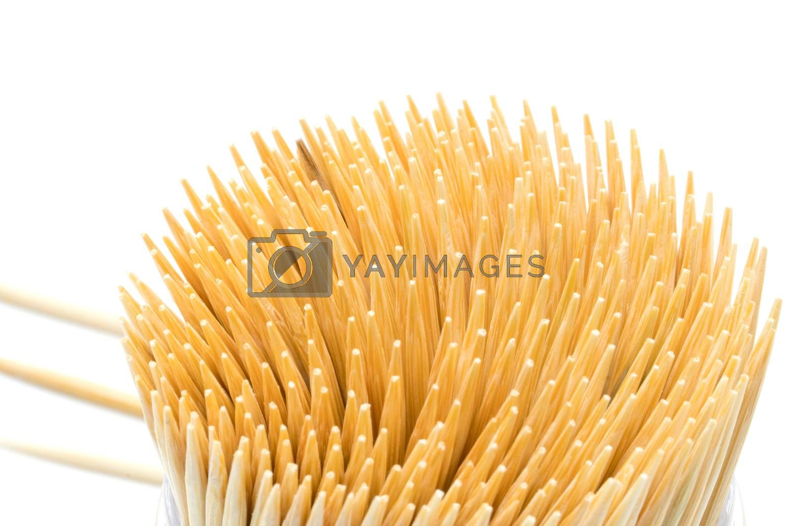 Top view of bamboo toothpicks in round container isolated on white background