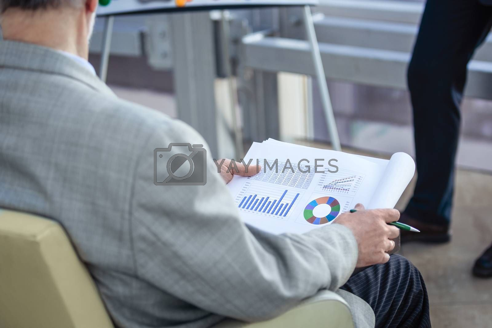 Business man at financial presentation by ALotOfPeople