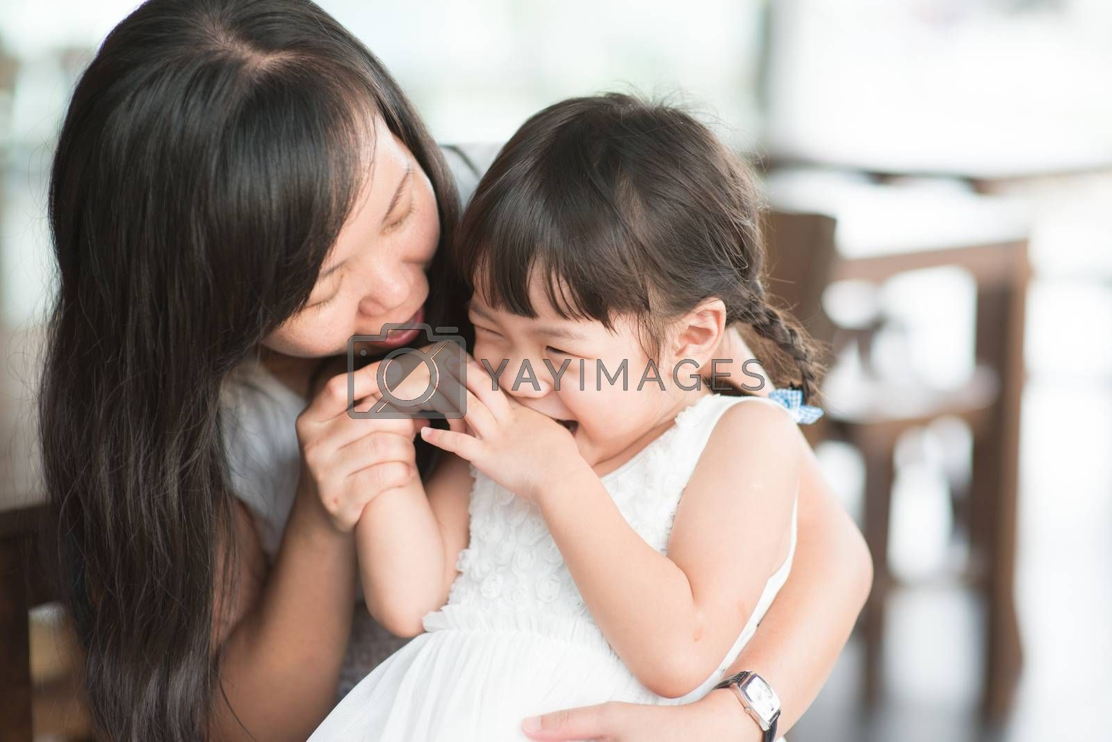 Candid shoot of people in cafeteria. Little girl with various face expression. Asian family outdoor lifestyle with natural light.