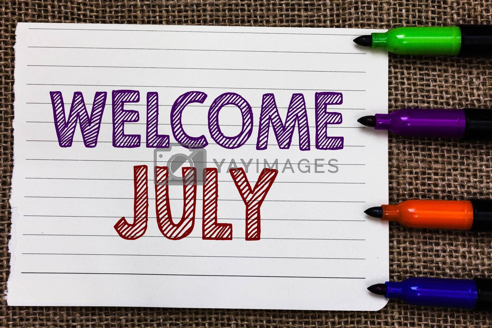 Conceptual hand writing showing Welcome July. Business photo showcasing Calendar Seventh Month 31days Third Quarter New Season Notebook Paper Important reminder Markers Jute background