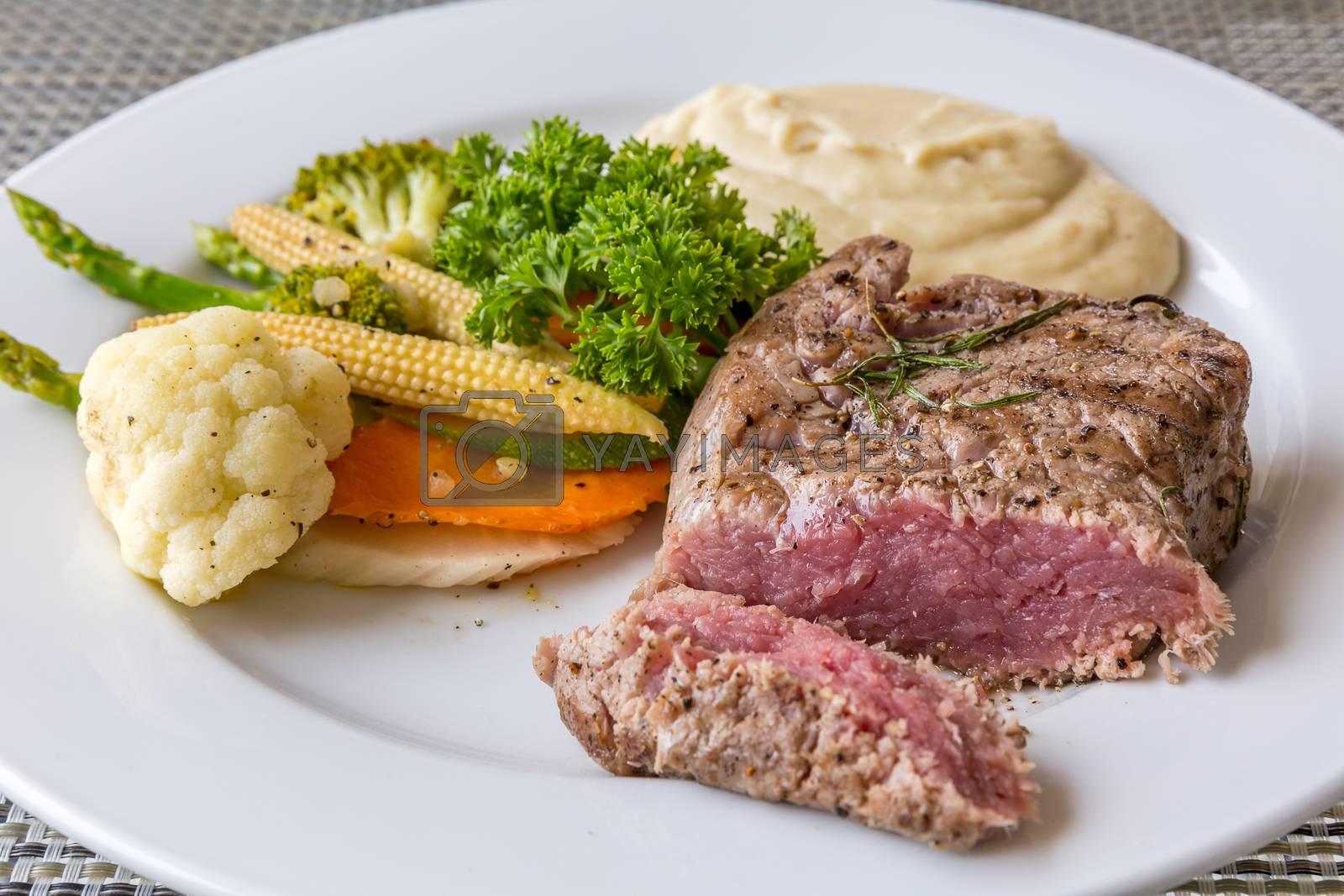 grilled fillet steak served with grilled vegetable and mash potato