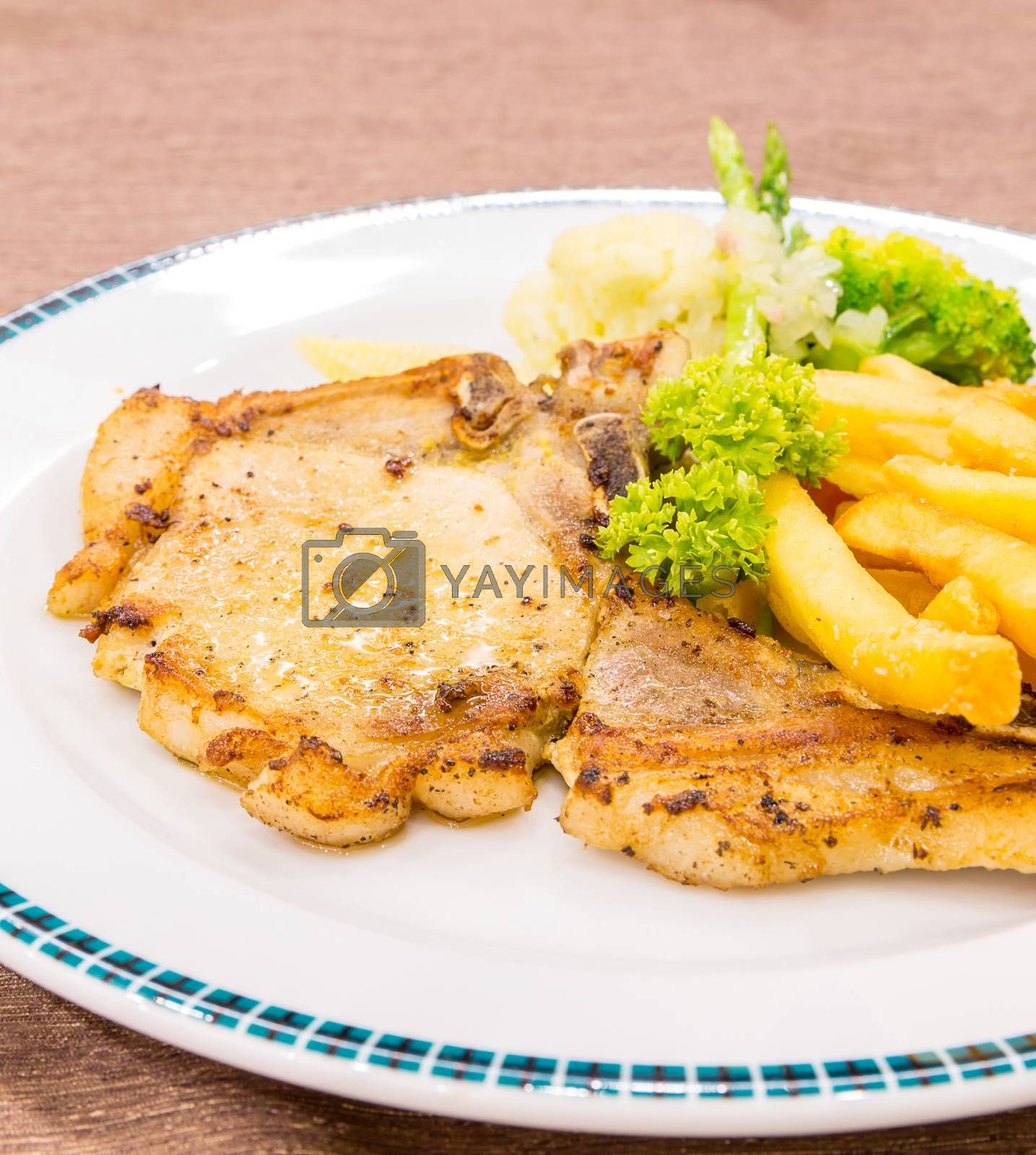 grilled pork chops with french fries