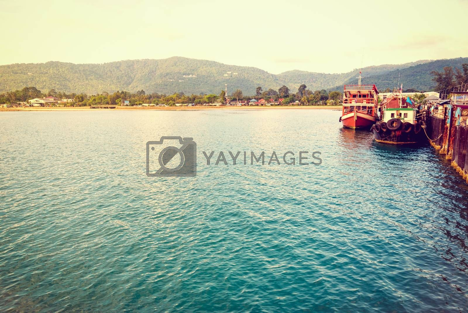 Vintage style wooden boat for dive tour docked at Nathon Pier near Nathon Beach with a peaceful sea atmosphere in the evening at Koh Samui island, Surat Thani province, Thailand