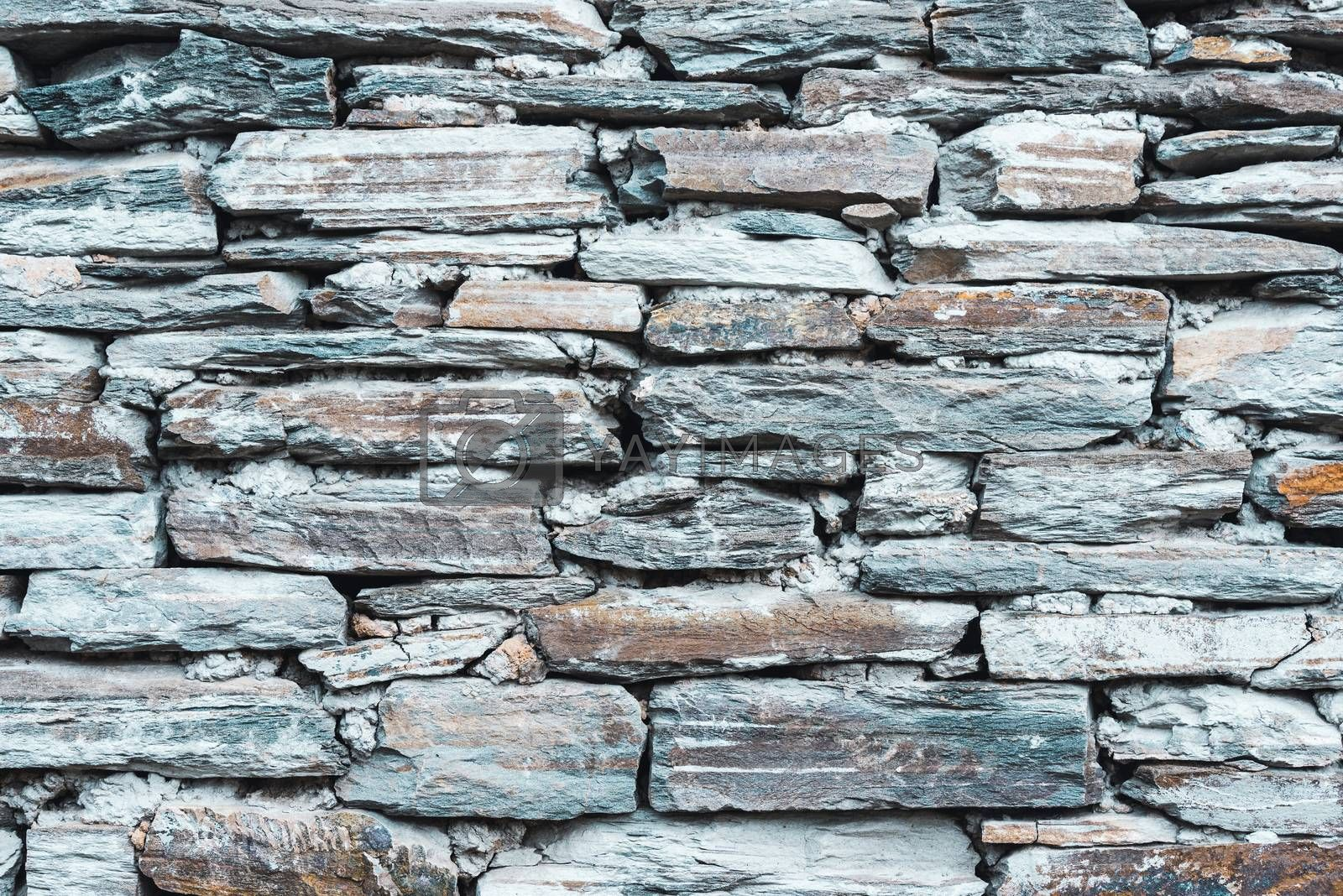 Old grey stone wall texture