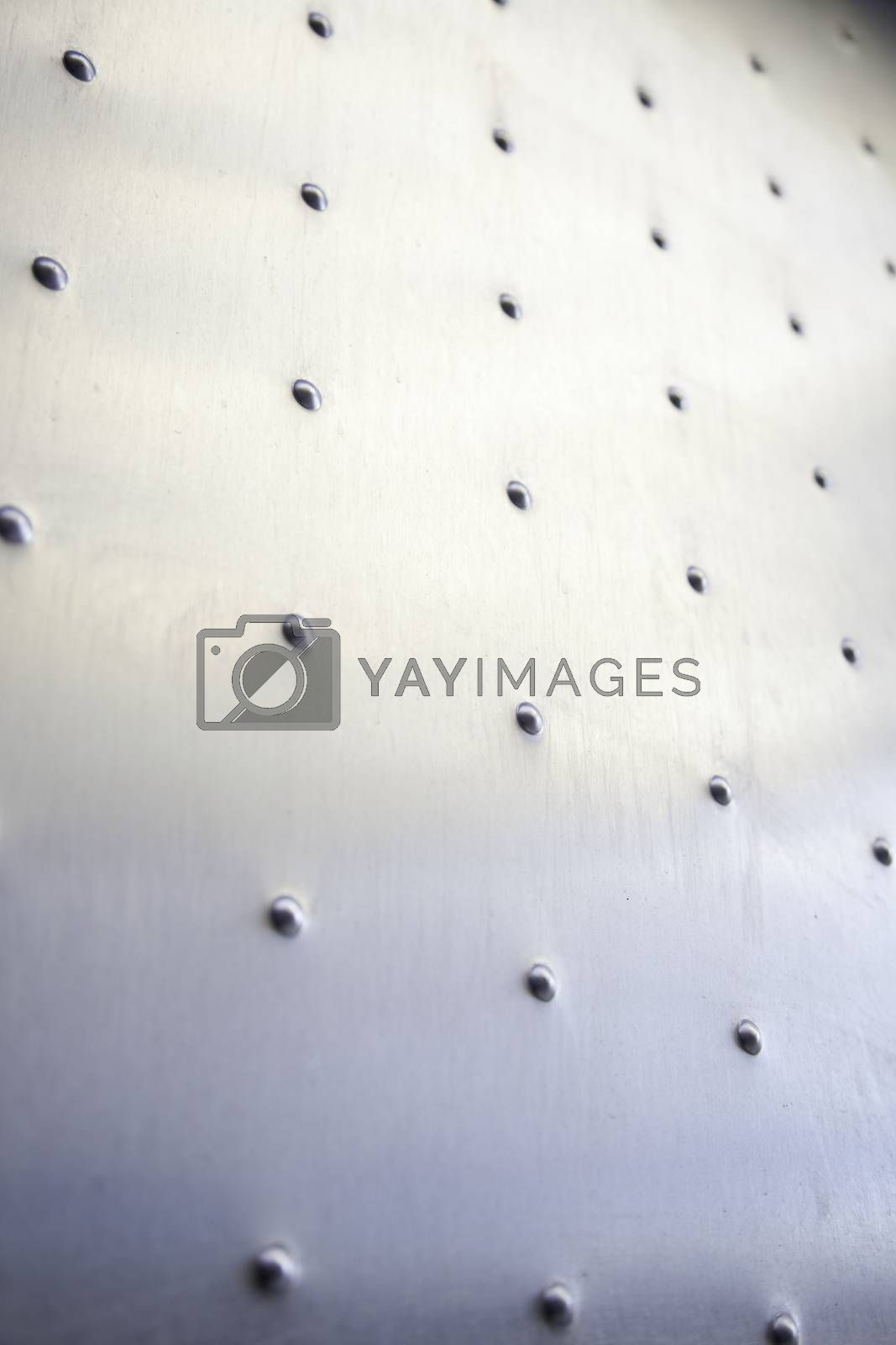 Metallic texture background, detail of a wall decorated with metal, steel and aluminum in the decoration, outdoor