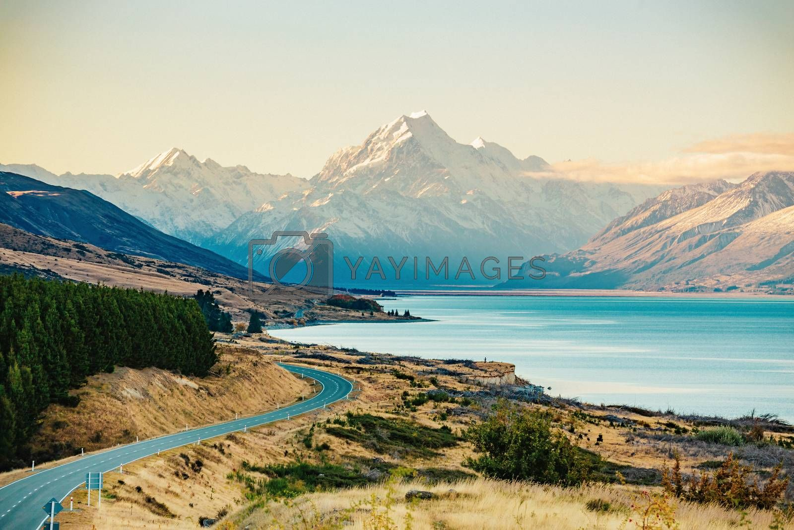 Road to Mt Cook, the highest mountain in New Zealand. Scenic highway drive along Lake Pukaki in Aoraki Mt Cook National Park, South Island of New Zealand.