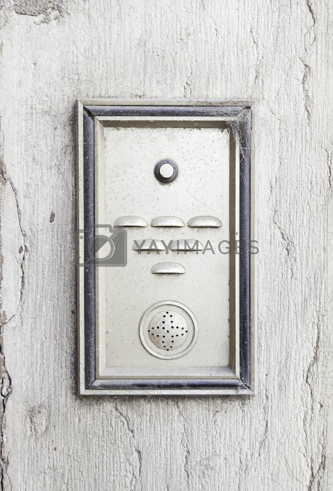 Old intercom in a house, detail of a electric apparatus in the facade of a building
