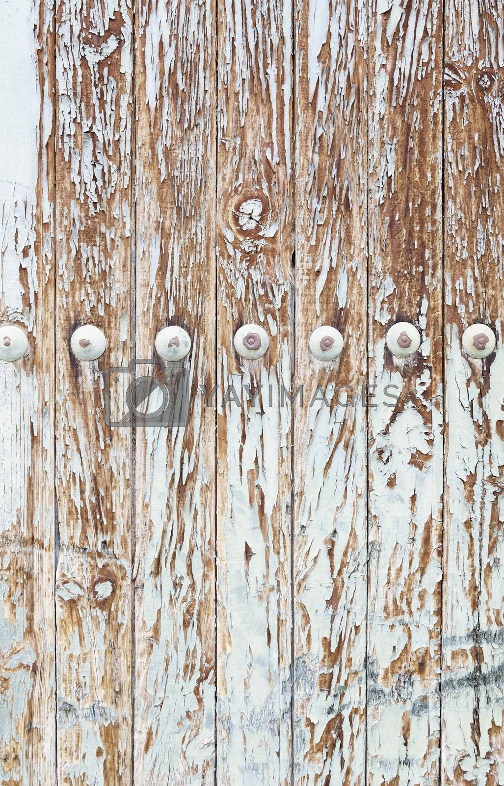 Wooden wall damaged, detail of an old wooden wall coated, decoration and neglect