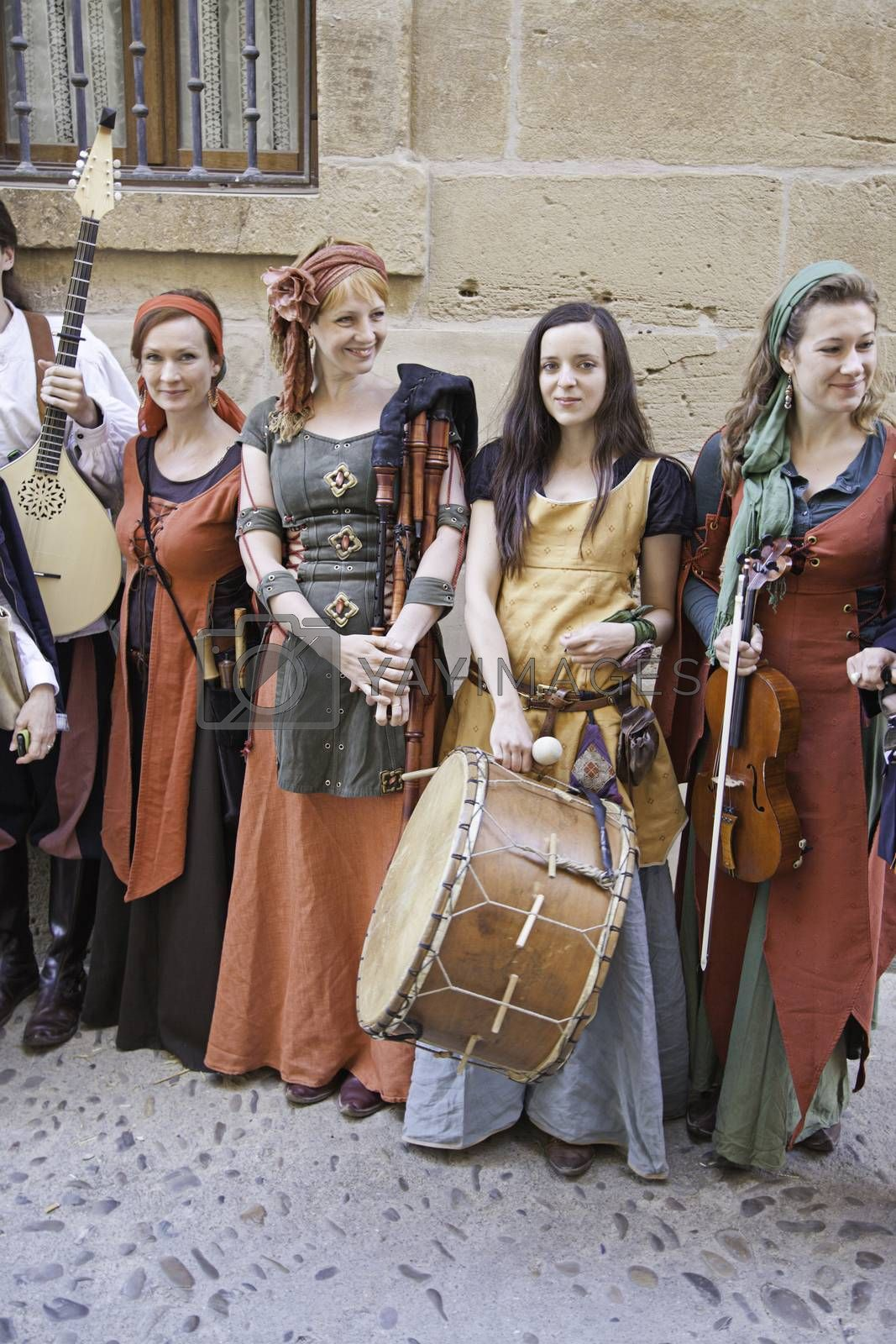 Group medieval musicians, detail of a group of beautiful women who play ancient music