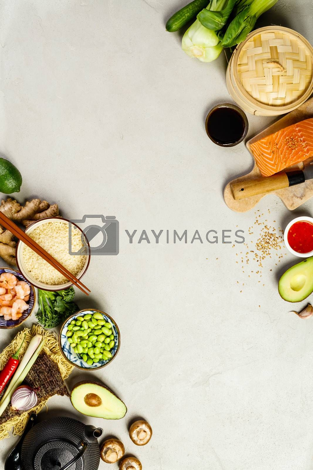 Asian cuisine ingredients on concrete background, top view. Vegetables, spices, shrimp, noodles, rice, sauces for cooking vietnamese, thai or chinese food. Clean eating food concept