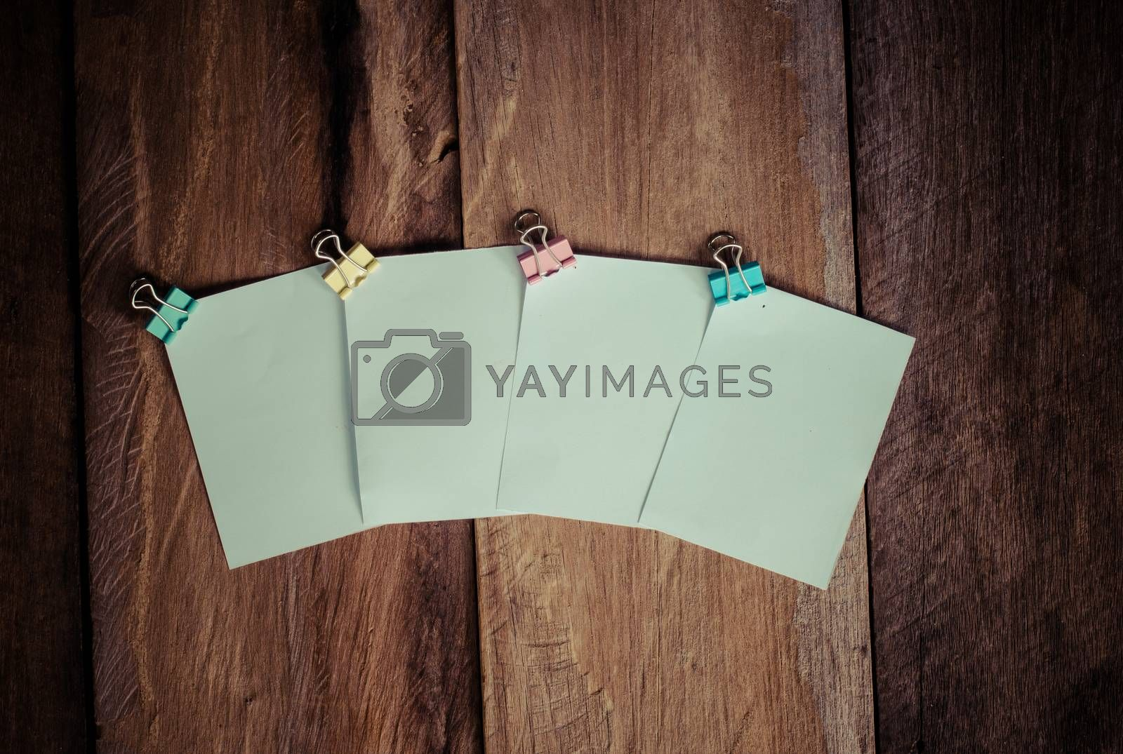 paper note on wooden background