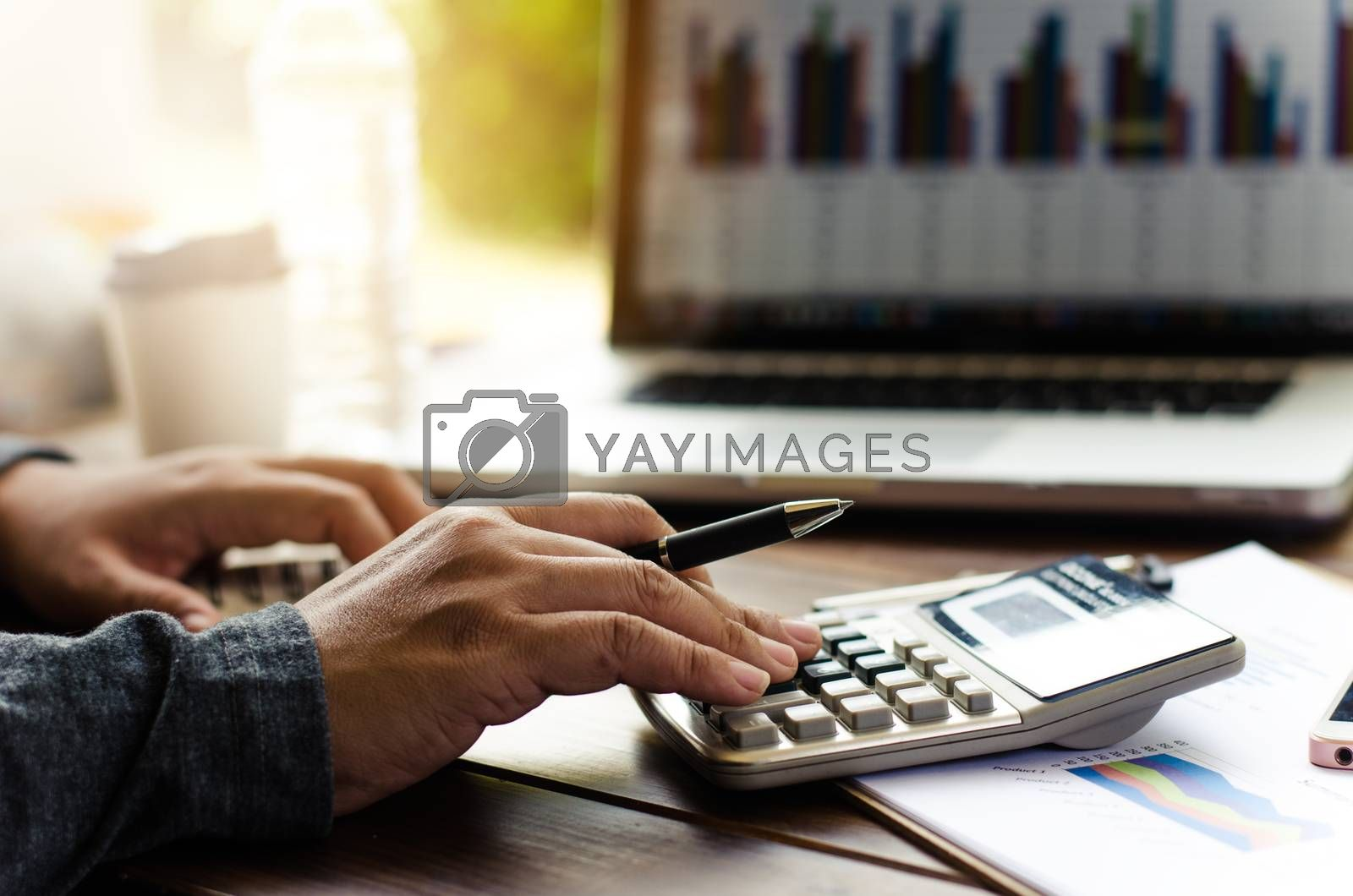 Working on a desk numerical analysis, financial accounting. Graphing Calculator on laptop
