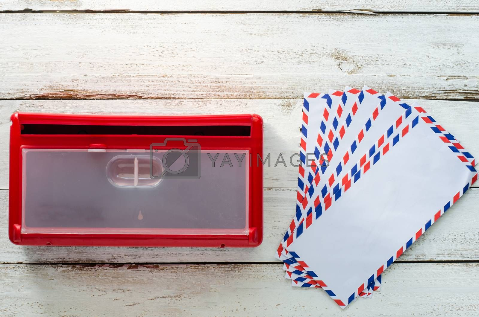 Red envelope mailboxes are placed on a wooden floor.