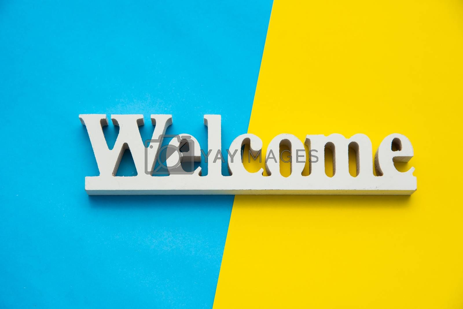 """Top view for """"Welcome"""" sign on a colorful background."""