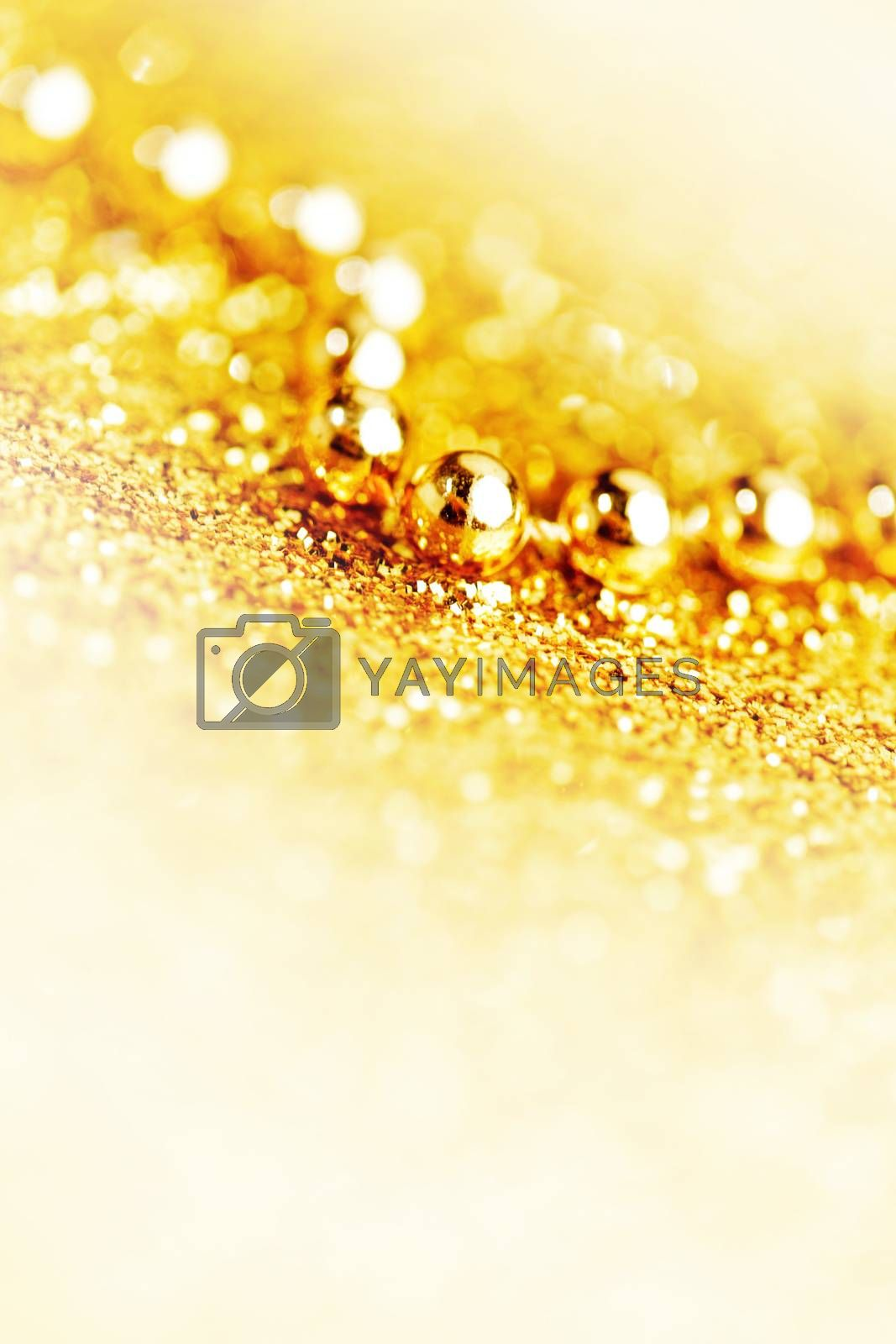 Gold christmas tree garland on glitter background close-up