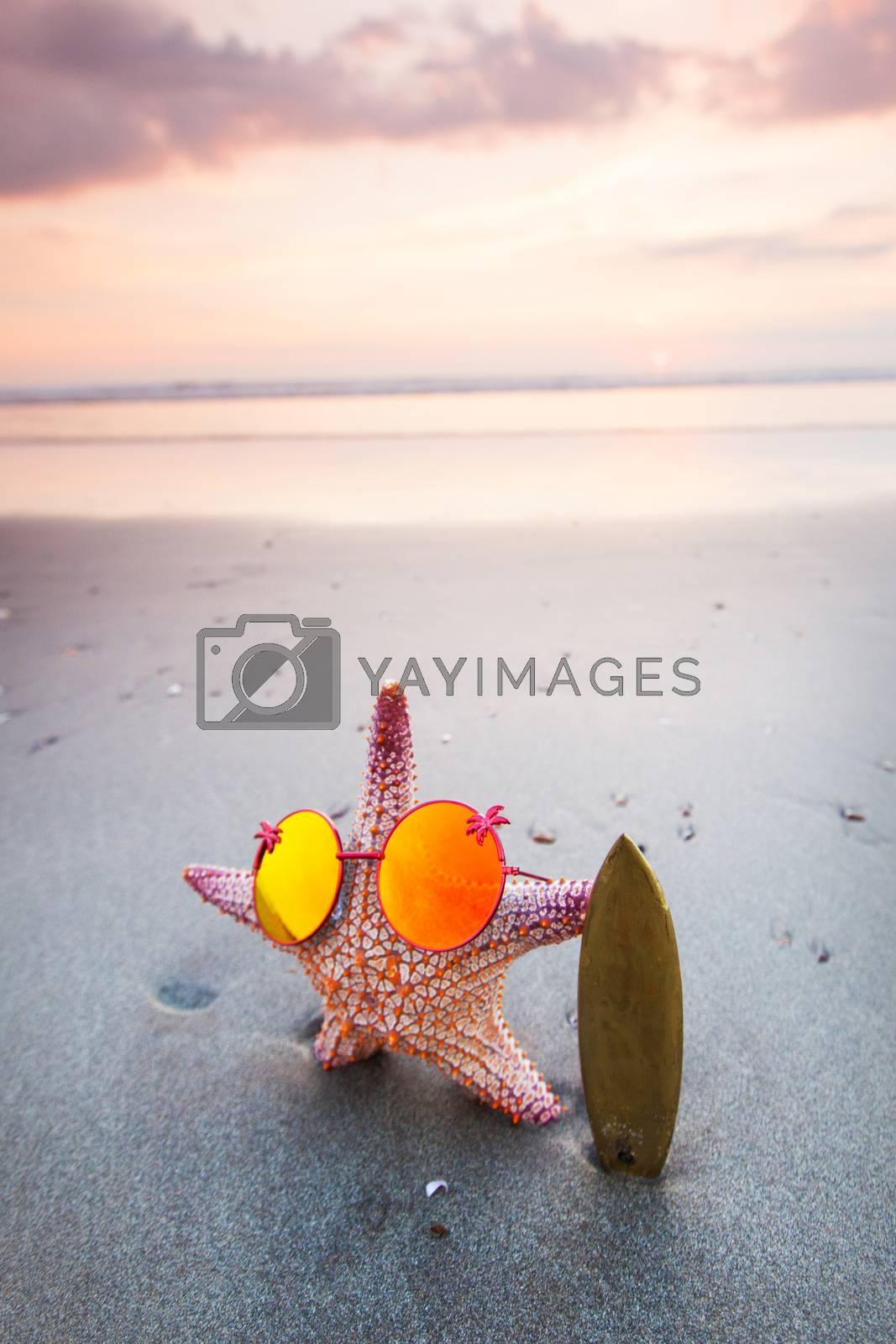 Starfish surfer on the beach and beautiful sunset on Bali