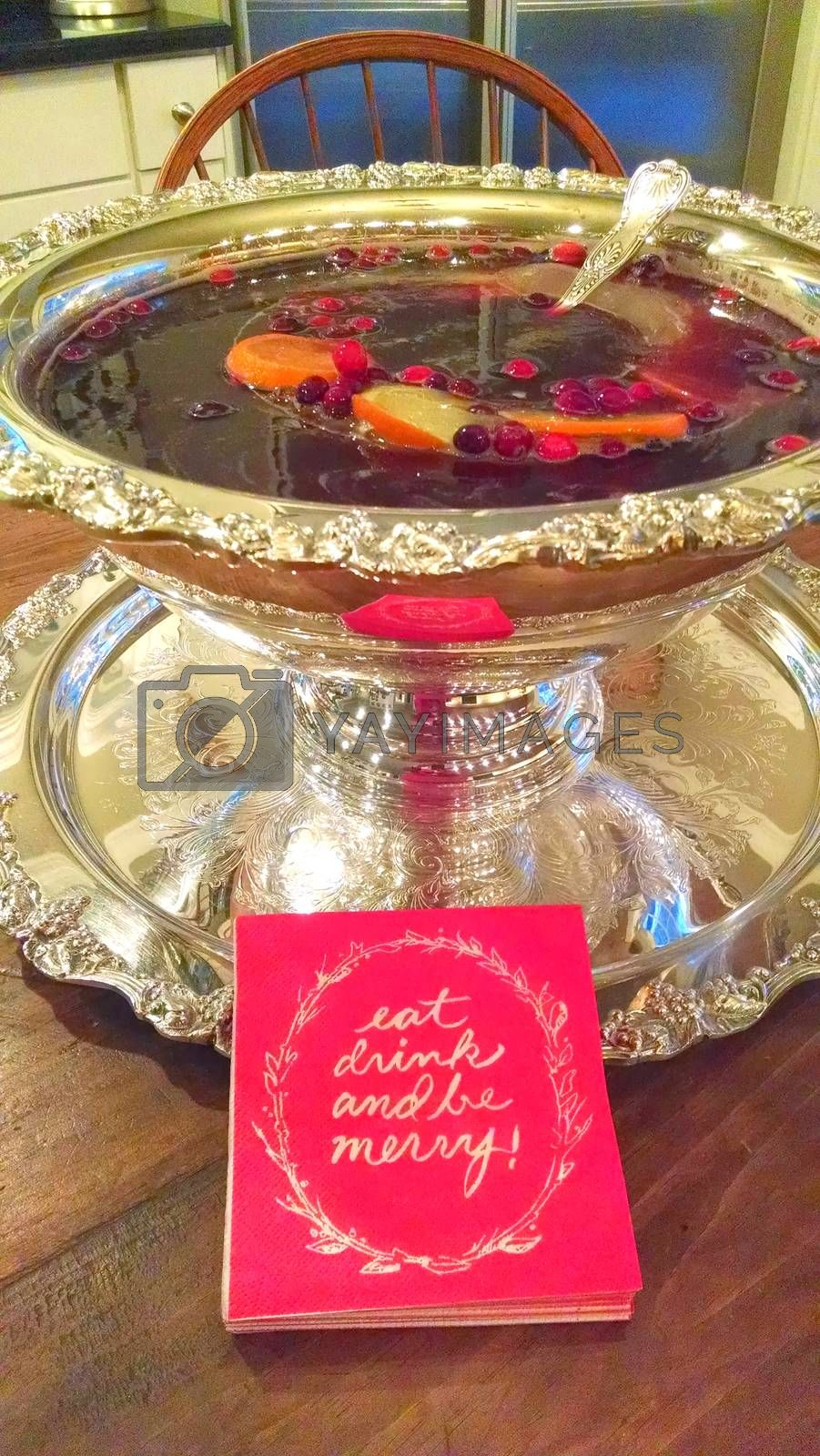 Christmas cocktail punch in Silver holiday serving bowl eat drink be merry