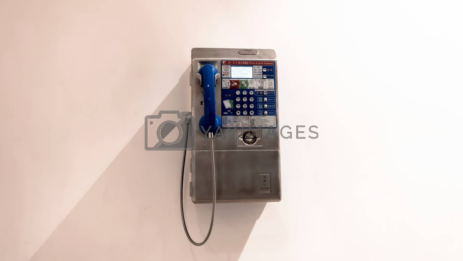 New Taipei City, Taiwan - October 21, 2018: public telephone coin and card in Mitsui Outlet Park