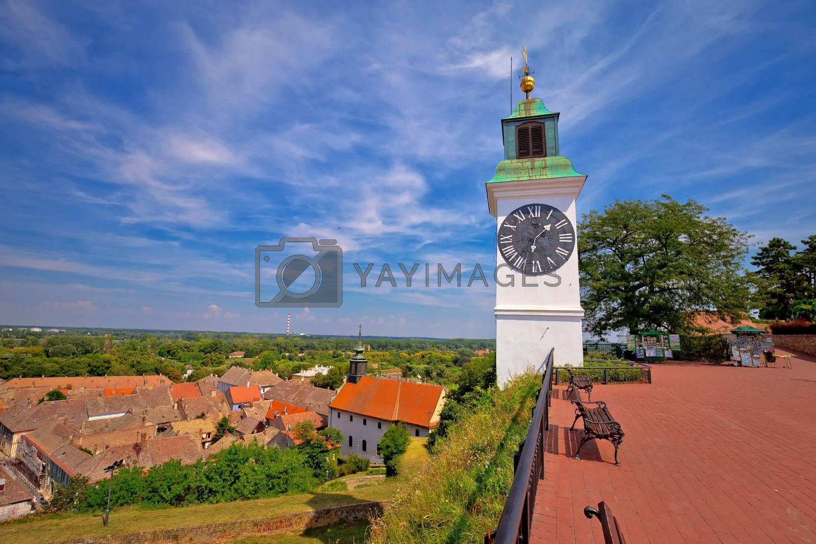 Petrovaradin clock tower and rooftops on Danube coast view, Novi Sad in Vojvodina region of Serbia